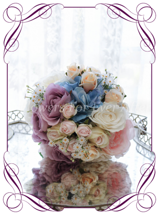Silk Artificial Bridesmaids posy bouquet featuring faux flower blue hydrangea and roses in a classical style and pastel tones. Made in Melbourne, worldwide shipping available