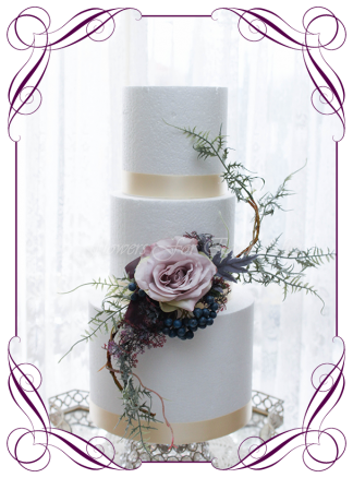 Unusual silk artificial mauve and woodland style cake decoration topper. Mauve rose with navy berries, silver fern and vine. Made in Melbourne. Buy online. Shipping world wide. Wedding cake decoration florals, engagement, baby,birthday cake, baby shower, communion, confirmation.