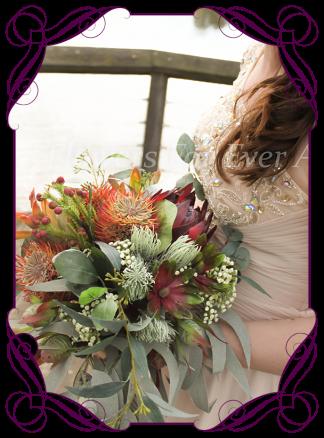 Silk artificial faux Australian native bridal bouquet, wedding flowers. Burgundy and burnt orange rust, protea banksia gum leaf foliage. Made in Melbourne by Australia's best wedding florist. Buy online.