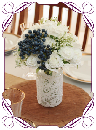 Silk faux flowers table centrepiece decorations for a wedding, engagement, birthday party, communion, confirmation, baby shower, baby boy shower, ideas. With white roses, baby's breath and navy blue berries for mason jar. Buy online. Made in Australia. Shipping world wide.