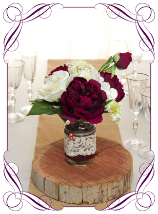Silk faux flowers table centrepiece decorations for a wedding, engagement, birthday party, communion, confirmation, baby shower, baby shower, ideas. With plum burgundy and ivory white roses, peonies, hydrangea for mason jar. Buy online. Made in Australia. Shipping world wide.