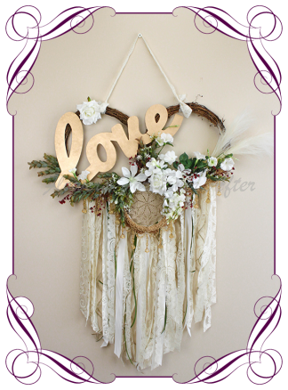 Silk artificial backdrop, arbor, arch, wall decoration love word in gold. Boho style with ivory, burgundy, pampas grass, lace and beads. For wedding or engagement decoration backdrop. Made in Melbourne. Shipping worldwide.