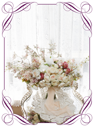 A Gorgeous Silk Artificial Bridal Bouquet posy, featuring faux flower peonies, roses, ranunculi, babies breath, and textures in a romantic elegant and unusual bridal style, blush pink wedding flowers, traditional wedding bouquets. Made in Melbourne by Australia's Best Artificial Bridal Florist. Worldwide Shipping available