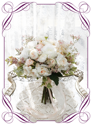 A Gorgeous Silk Artificial Bridesmaid Bouquet posy, featuring faux flower peonies, roses, ranunculi, babies breath, and textures in a romantic elegant and unusual bridal style, blush pink wedding flowers, traditional wedding bouquets. Made in Melbourne by Australia's Best Artificial Bridal Florist. Worldwide Shipping available