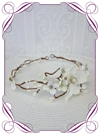 Silk artificial all white with pearls and bling crystals floral hair crown halo. Ideal for wedding, Communion, Confirmation hair decoration. Made in Melbourne Australia. Buy online. Ships worldwide.